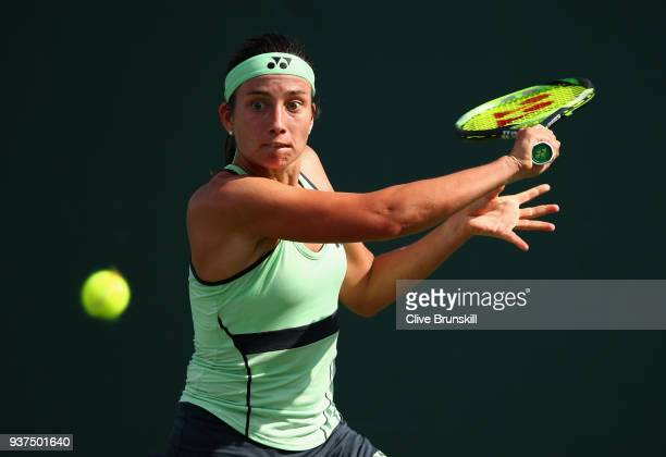 Anastasija Sevastova of Latvia plays a backhand against Victoria Azarenka of Belarus in their third round match during the Miami Open Presented by...