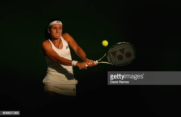 Anastasija Sevastova of Latvia plays a backhand during the Ladies Singles first round match against Yulia Putintseva of Kazakhstan on day one of the...