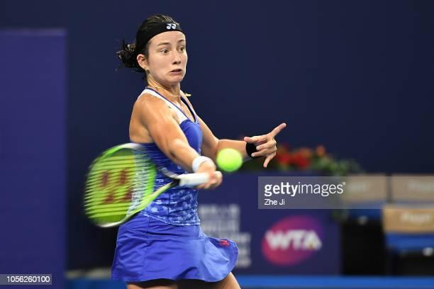 Anastasija Sevastova of Latvia returns a shot against Garbine Muguruza of Spain during their women's singles match on day 4 of the 2018 WTA Elite...