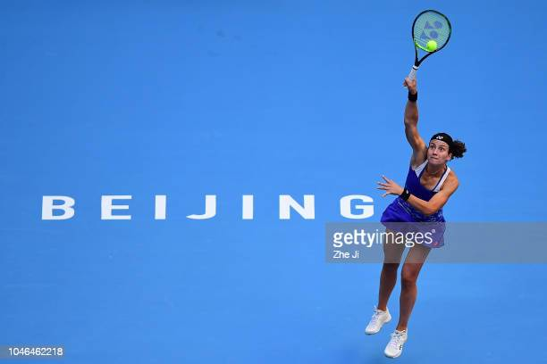 Anastasija Sevastova of Latvia returns a shot against Naomi Osaka of Japan during her women's singles semifinal match on day 8 of 2018 China Open at...