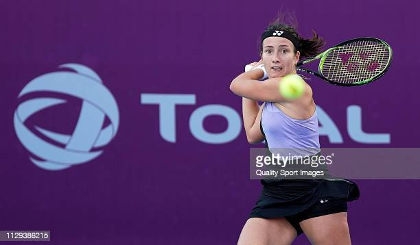 Anastasija Sevastova of Latvia returns a shot during her match against Anna Blinkova of Russia during day two of the Qatar Total Open 2019 at Khalifa...
