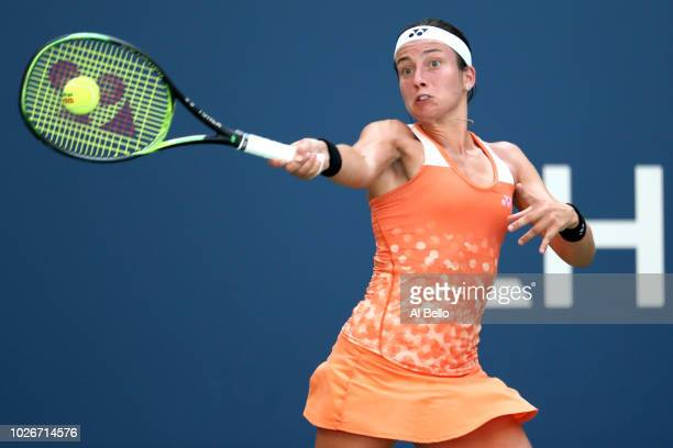 Anastasija Sevastova of Latvia returns the ball during the ladies singles quarterfinal match against Sloane Stephens of The United States on Day Nine...