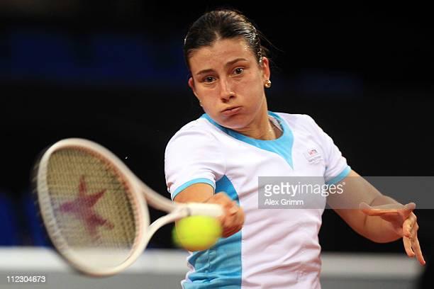 Anastasija Sevastova of Latvia returns the ball to Na Li of China during their first round match at the Porsche Tennis Grand Prix at Porsche Arena on...