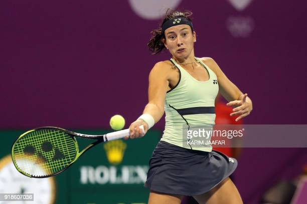 Anastasija Sevastova of Latvia returns the ball to Simona Halep of Romania while competing in the round of 16 during the Qatar Open tennis...