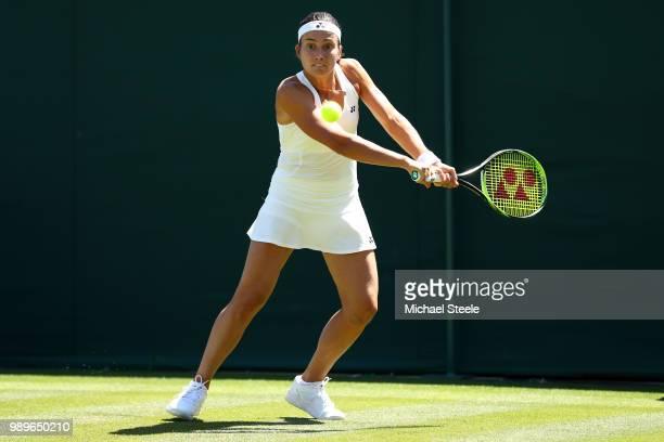 LONDON ENGLAND JULY Anastasija Sevastova of Latvia returns to Camila Giorgi of Italy during their Ladies' Singles first round match on day one of the...