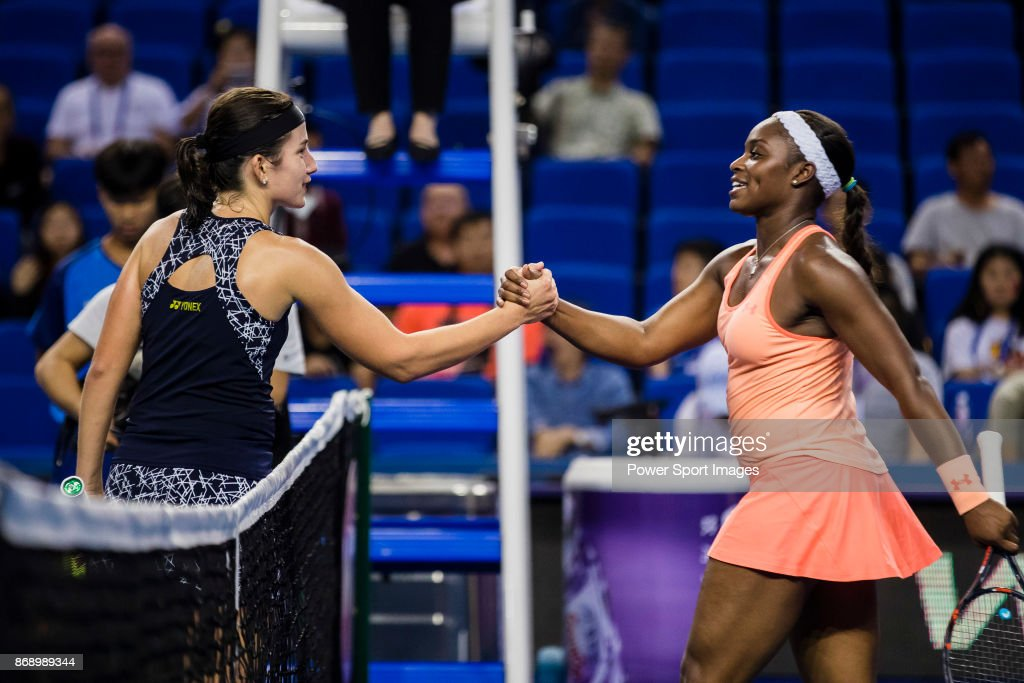 Anastasija Sevastova of Latvia (L) shakes hand with Sloane Stephens of the United States (R) after winning the singles Round Robin match of the WTA Elite Trophy ZHUHAI 2017 at Hengqin Tennis Center on November 01, 2017 in Zhuhai, China.