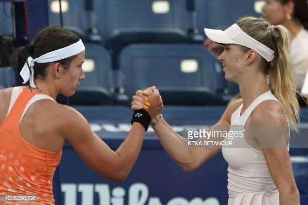 Anastasija Sevastova of Latvia shakes hands with ElinaSvitolina of Ukraine after winning their women's singles match on Day 7 of the 2018 US Open at...