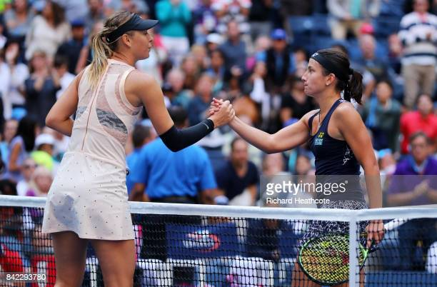 Anastasija Sevastova of Latvia shakes hands with Maria Sharapova of Russia after defeating her in their women's singles fourth round match on Day...