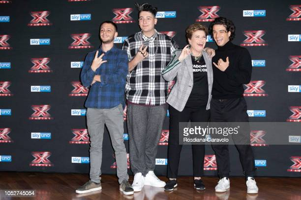 Anastasio Emanuele Bertelli Mara Maionchi and Leo Gassmann attend X Factor 2018 photocall at Teatro Linear Ciak on October 22 2018 in Milan Italy