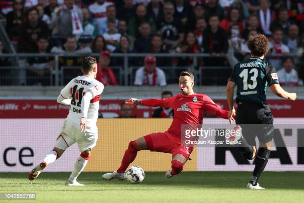 Anastasios Donis of Stuttgart challenges Jiri Pavlenka of Bremen during the Bundesliga match between VfB Stuttgart and SV Werder Bremen at...