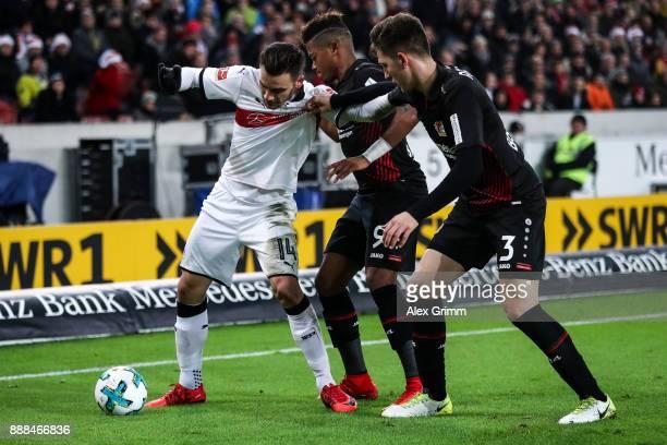 Anastasios Donis of VfB Stuttgart Leon Bailey of Bayer Leverkusen and Panagiotis Retsos of Bayer Leverkusen battle for the ball during the Bundesliga...