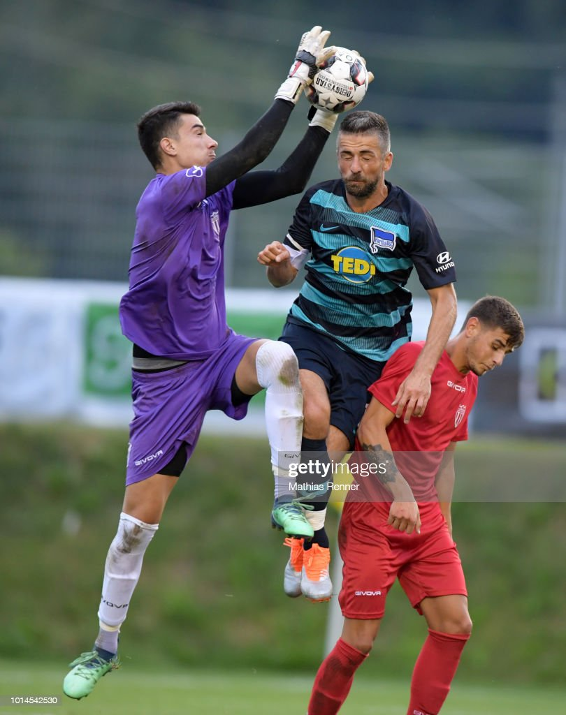Anastasios Karagiozis of Aiginiakos FC and Vedad Ibisevic of Hertha BSC during the test test match between Hertha BSC and Aiginiakos FC at the Athletic Area Schladming on august 10, 2018 in Schladming, Austria.