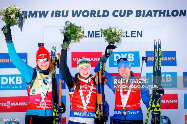 Anastasiya Kuzmina from Slovakia winner Darya Domracheva from Belarus and Susan Dunklee from the US celebrate on the podium after the IBU Biathlon...