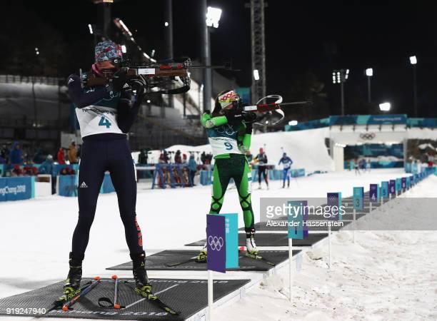 Anastasiya Kuzmina of Slovakia and Darya Domracheva of Belarus shoot during the Women's 125km Mass Start Biathlon on day eight of the PyeongChang...