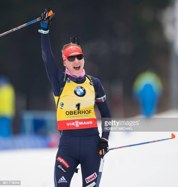 Anastasiya Kuzmina of Slovakia celebrates after winning the women's 10 km pursuit event of the IBU Biathlon World Cup in Oberhof eastern Germany on...