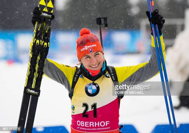 Anastasiya Kuzmina of Slovakia celebrates after winning the women's 75 km sprint event at the IBU Biathlon World Cup in Oberhof central Germany on...