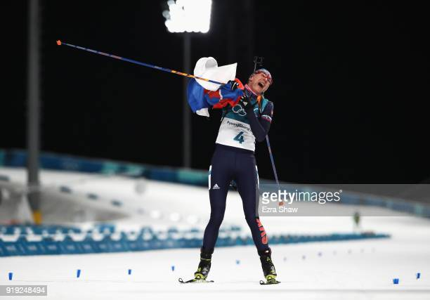 Anastasiya Kuzmina of Slovakia celebrates as she approaches the finish line to to win gold during the Women's 125km Mass Start Biathlon on day eight...