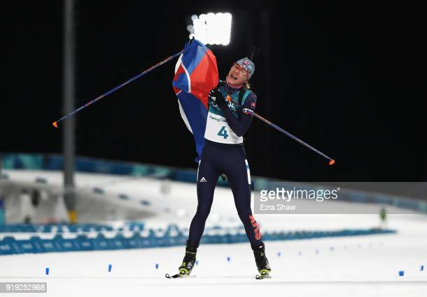 Anastasiya Kuzmina of Slovakia celebrates as she approaches the finish line to to win gold during the Women's 125km Mass Start Biathlon on day eight...
