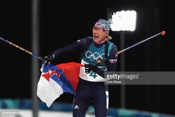 Anastasiya Kuzmina of Slovakia celebrates as she wins gold during the Women's 125km Mass Start Biathlon on day eight of the PyeongChang 2018 Winter...