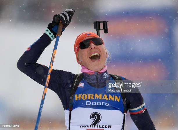 Anastasiya Kuzmina of Slovakia celebrates crossing the finish line of the 10 km Women's Pursuit during the BMW IBU World Cup Biathlon on December 0...