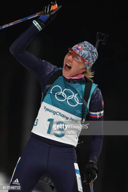 Anastasiya Kuzmina of Slovakia celebrates her time after crossing the finish line during the Women's Biathlon 10km Pursuit on day three of the...