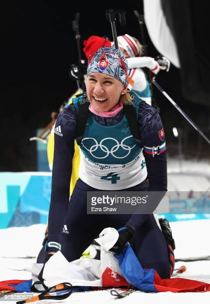 Anastasiya Kuzmina of Slovakia celebrates winning the gold medal during the Women's 125km Mass Start Biathlon on day eight of the PyeongChang 2018...