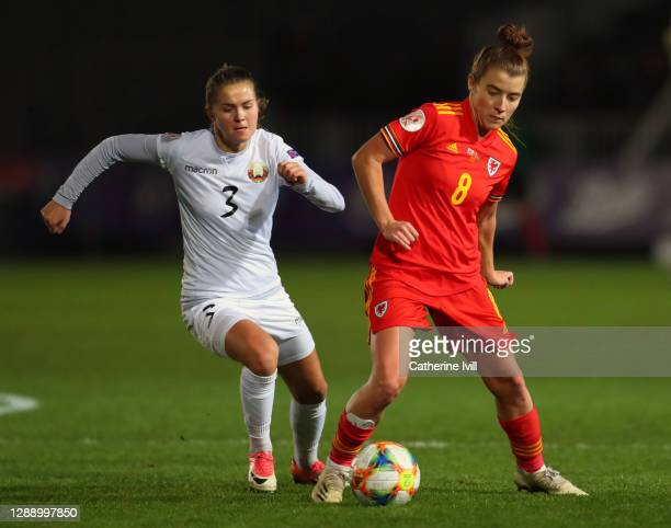 Anastasiya Linnik of Belarus and Angharad James of Wales during the UEFA Women's EURO 2022 Qualifier between Wales and Belarus at Rodney Parade on...