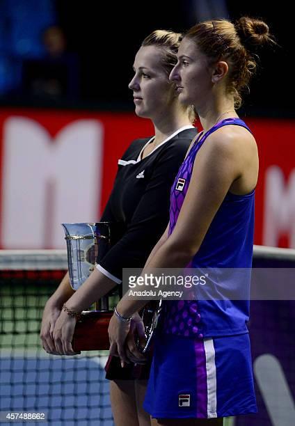 Anastasiya Pavlyucenkova of Russia and Irina-Camelia Begu of Romania pose together at the end of the Kremlin Cup 2014 International Tennis Tournament...