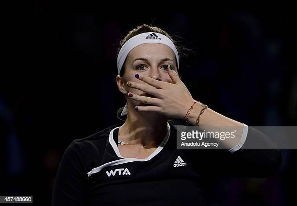 Anastasiya Pavlyucenkova of Russia greets the audience after defeating Irina-Camelia Begu of Romania at the end of the Kremlin Cup 2014 International...
