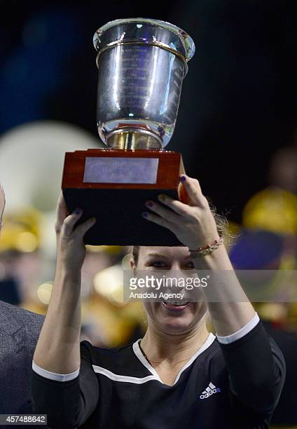 Anastasiya Pavlyucenkova of Russia holds the winner's cup after defeating Irina-Camelia Begu of Romania at the end of the Kremlin Cup 2014...
