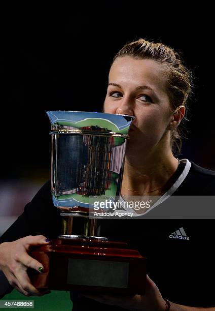 Anastasiya Pavlyucenkova of Russia kisses the winner's cup after defeating Irina-Camelia Begu of Romania at the end of the Kremlin Cup 2014...