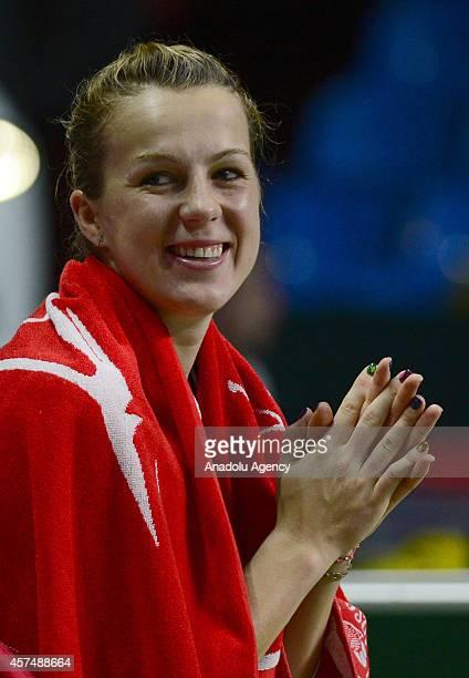 Anastasiya Pavlyucenkova of Russia laughs after defeating Irina-Camelia Begu of Romania at the end of the Kremlin Cup 2014 International Tennis...