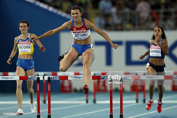 Anastasiya Rabchenyuk of Ukraine Natalya Antyukh of Russia and Queen Harrison of United States compete in the women's 400 metres semi finals during...