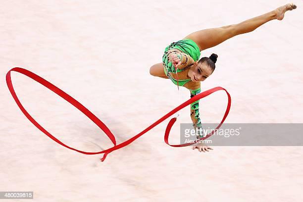 Anastasiya Serdyukova of Uzbekistan performs with the ribbon during the GAZPROM World Cup Rhythmic Gymnastics at Porsche Arena on March 22 2014 in...