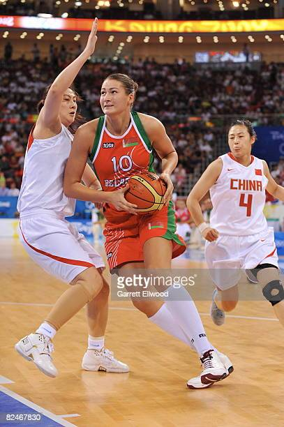 Anastasiya Verameyenka of Belarus drives against China during day 1 of the women's quater-finals basketball game at the 2008 Beijing Olympic Games at...