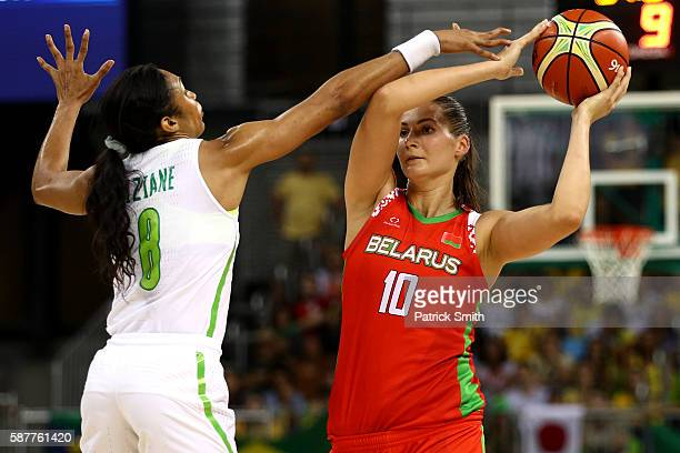 Anastasiya Verameyenka of Belarus looks to pass in front of Iziane Marques of Brazil in the Women's Basketball Preliminary Round Group A match...