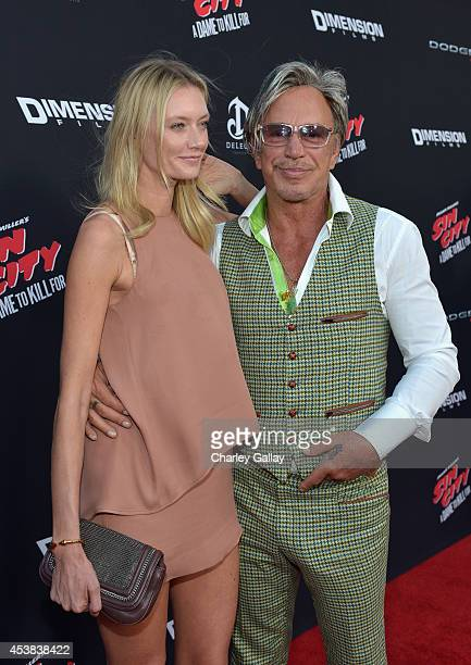 Anastassija Makarenko and actor Mickey Rourke attend 'SIN CITY A DAME TO KILL FOR' premiere presented by Dimension Films in partnership with Time...