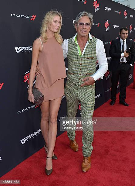 Anastassija Makarenko and actor Mickey Rourke attend SIN CITY A DAME TO KILL FOR premiere presented by Dimension Films in partnership with Time...