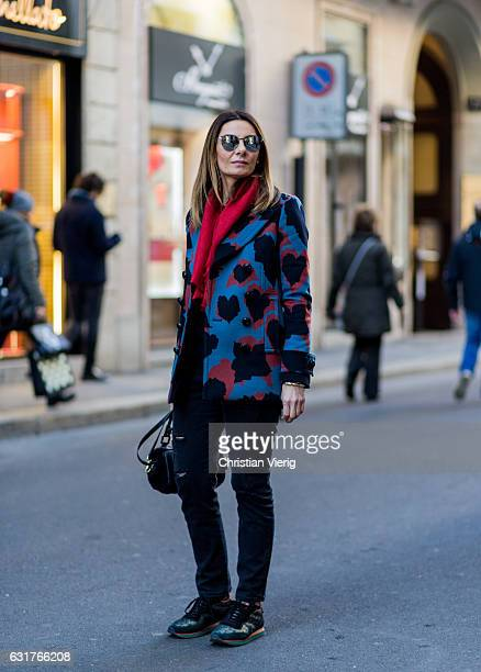 Anastasya Lanchava is wearing a coat Etro sneaker Gucci scarf during Milan Men's Fashion Week Fall/Winter 2017/18 on January 15 2017 in Milan Italy