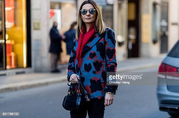 Anastasya Lanchava is wearing a coat Gucci scarf during Milan Men's Fashion Week Fall/Winter 2017/18 on January 15 2017 in Milan Italy