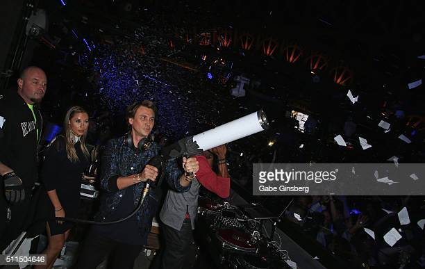Anat Popovsky watches reality star Jonathan Cheban shoot a confetti canon at the Chateau Nightclub Rooftop at the Paris Las Vegas to celebrate...