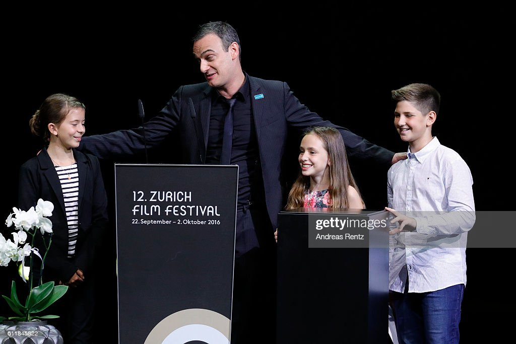 Anatole Taubman and kids present the 'ZFF for Kids' award on stage during the Award Night Ceremony during the 12th Zurich Film Festival on October 1, 2016 in Zurich, Switzerland. The Zurich Film Festival 2016 will take place from September 22 until October 2.