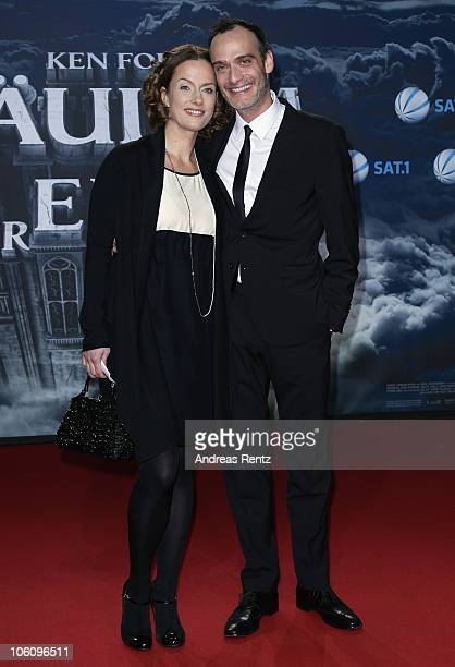 Anatole Taubmann and partner Claudia Michelsen arrive for the 'The Pillars of the Earth' premiere at CineStar on October 26 2010 in Berlin Germany