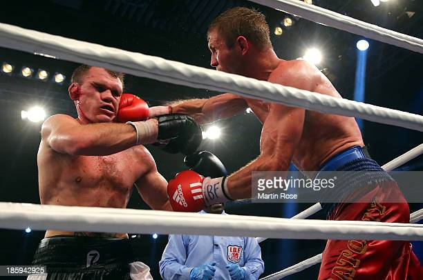Anatoliy Dudchenko of Ukraine exchange punches with Robert Woge of Germany during their IBF Intercontinental light heavyweight title fight at EWE...