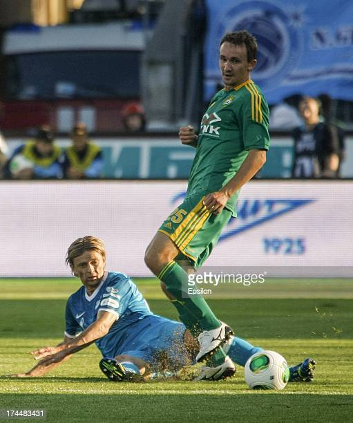 Anatoliy Tymoschuk of FC Zenit St Petersburg and Aleksei Kozlov of FC Kuban Krasnodar compete for the ball during the Russian Premier League match...