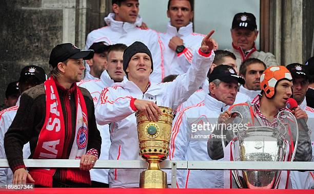Anatoliy Tymoshchuk, Bastian Schweinsteiger, Jupp Heynckes and Arjen Robben of FC Bayern Muenchen and their teammates celebrate winning the...