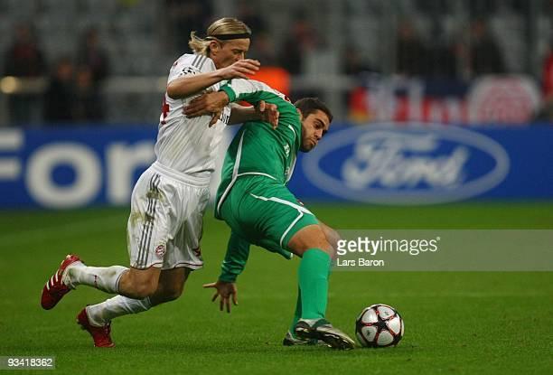 Anatoliy Tymoshchuk of Bayern and Shlomi Arbeitman of Haifa battle for the ball during the UEFA Champions League Group A match between FC Bayern...