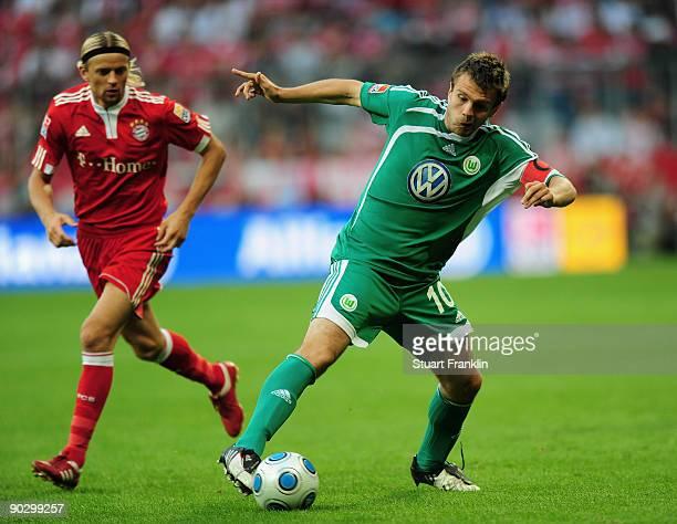 Anatoliy Tymoshchuk of Bayern challenges Zvjedzdan Misimovic of Wolfsburg during the Bundesliga match between FC Bayern Munich and VfL Wolfsburg at...