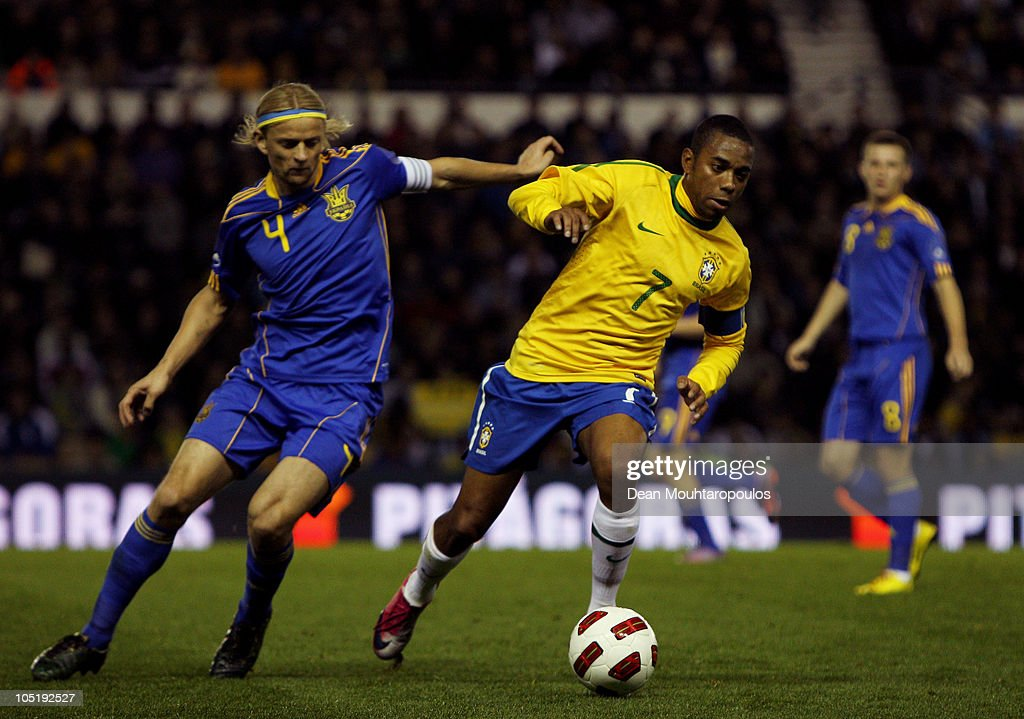 Anatoliy Tymoshchuk of Ukraine battles with Robinho of Brazil during the International Friendly match between Brazil and Ukraine at Pride Park Stadium on October 11, 2010 in Derby, England.