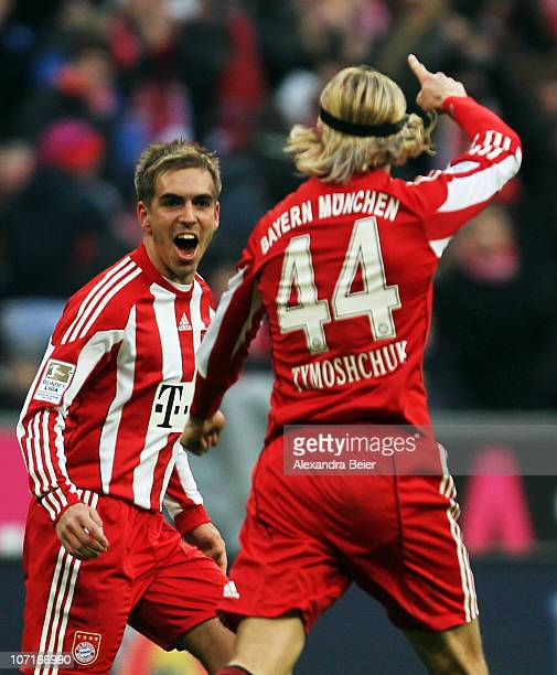 AnatoliyTymoshchuk of Bayern Muenchen celebrates after scoring his team's first goal together with team mate Philipp Lahm during the Bundesliga match...